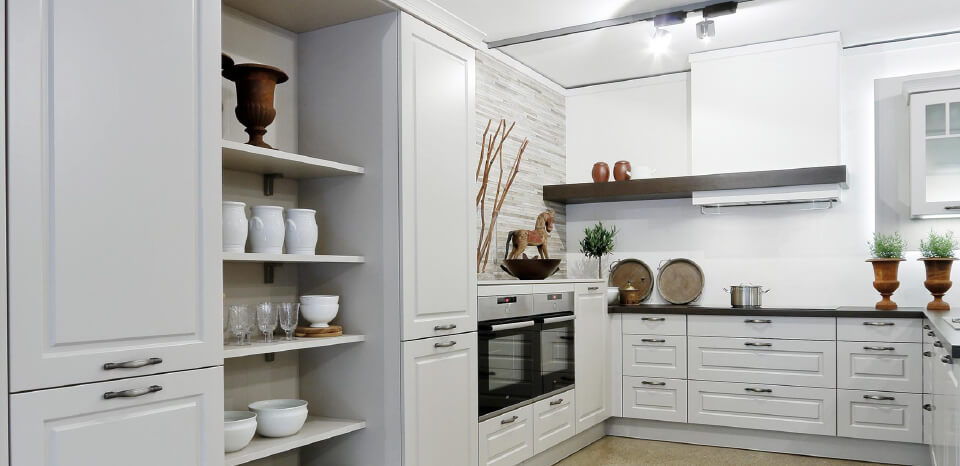 White kitchen decorated with wooden objects