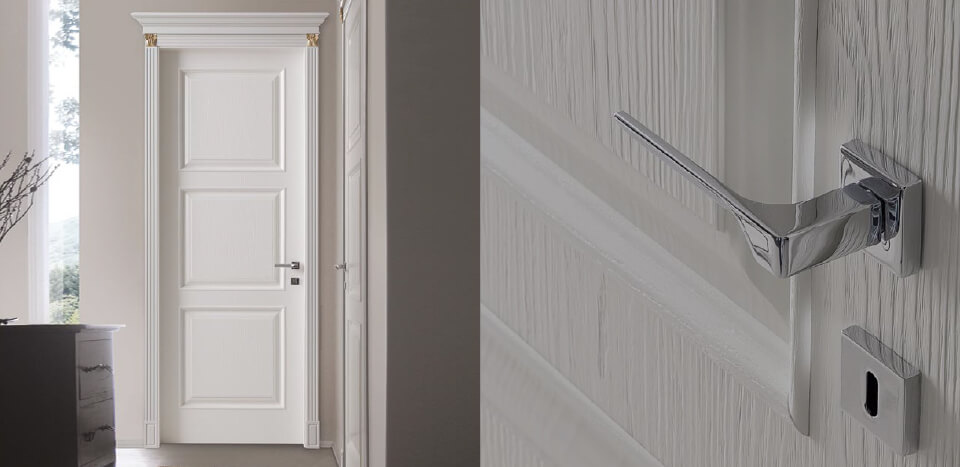 white home door with door handle and lock