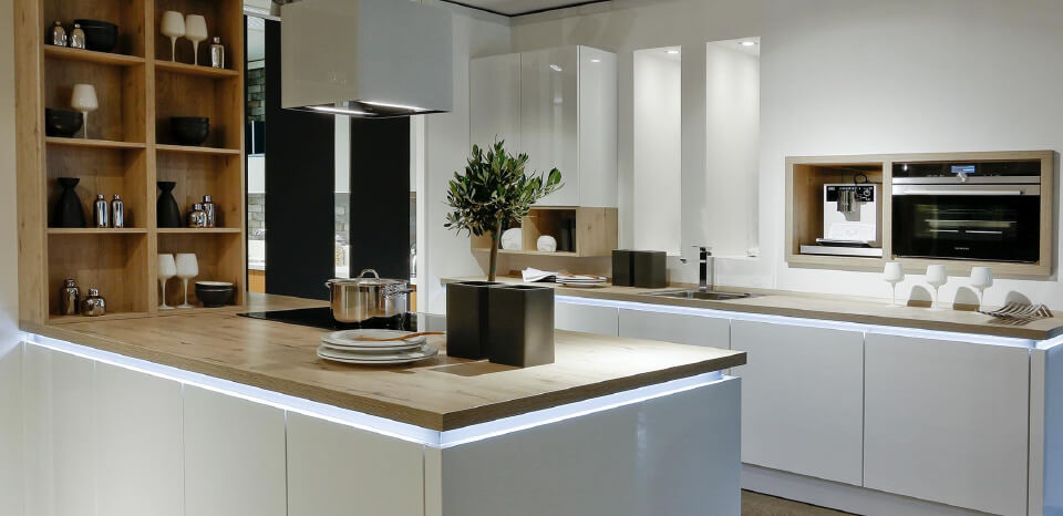 Modern White coloured theme based kitchen with a wooden touch to it