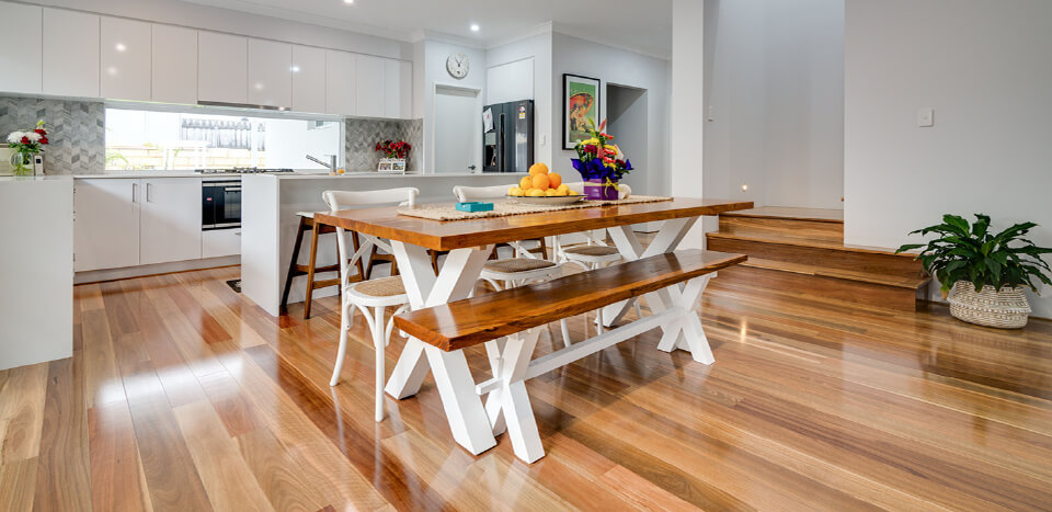 Wooden bench and wooden table on top of wooden flooring