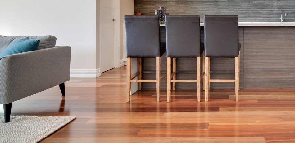 furnitures placed on top of a finely crafted wooden flooring