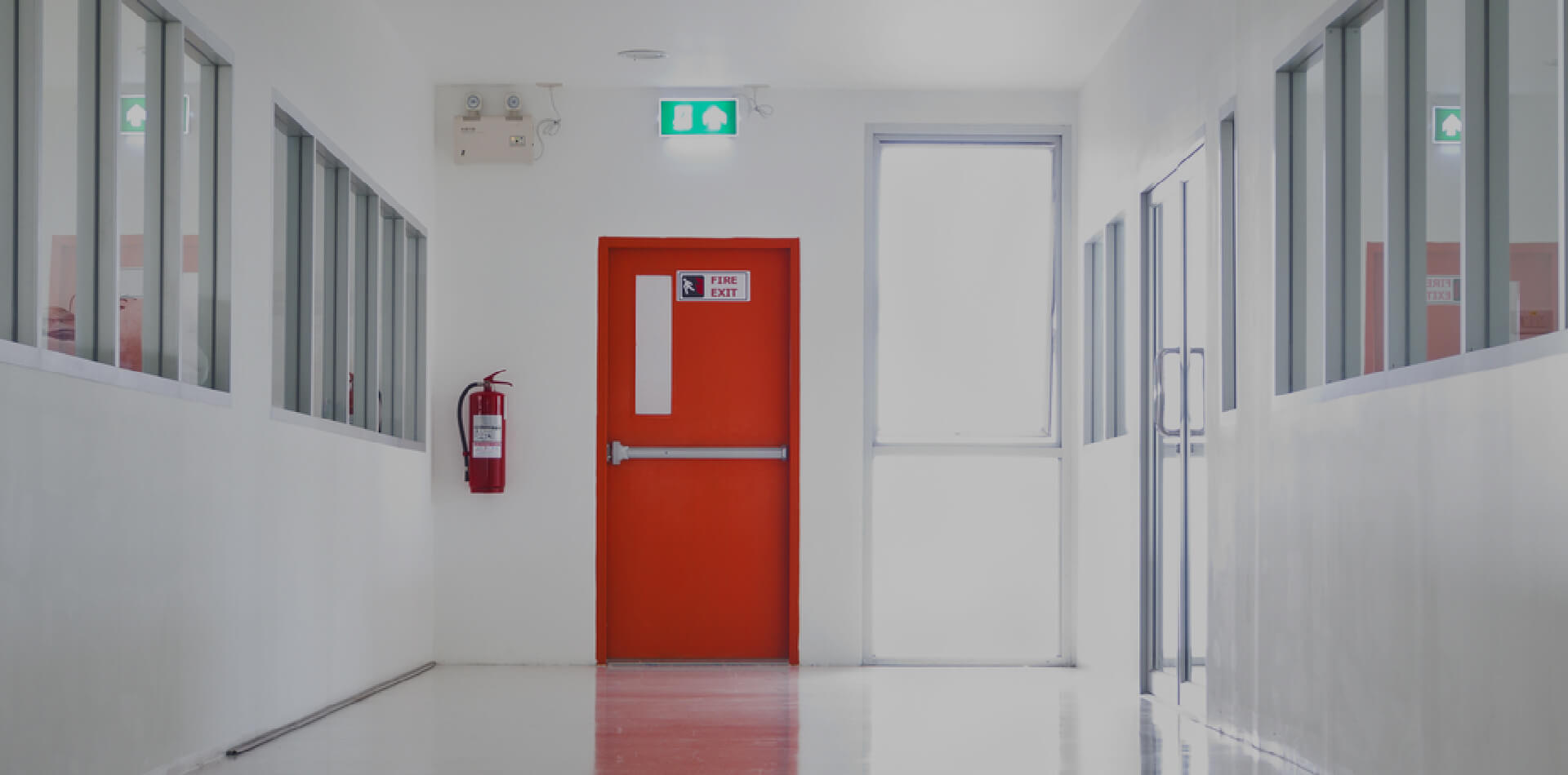 Fire exit door with fire extinguisher