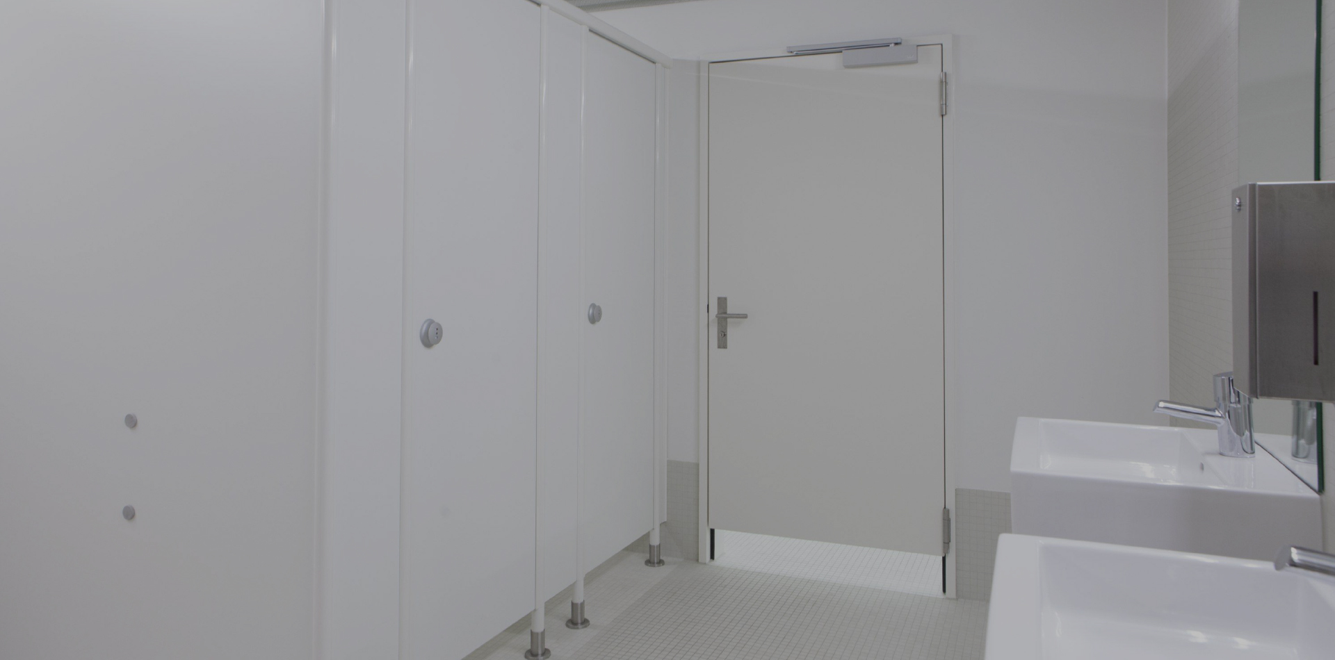 White themed restroom facility with sinks
