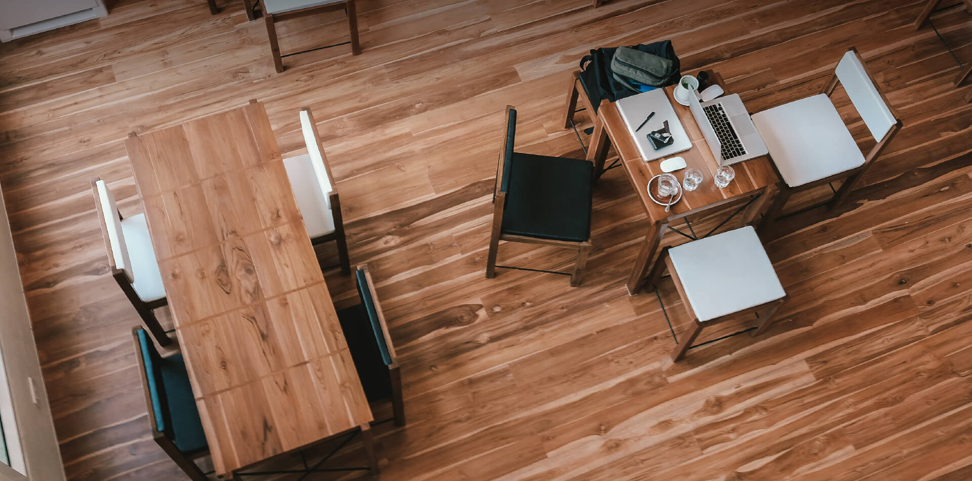 A room with wooden desks and flooring
