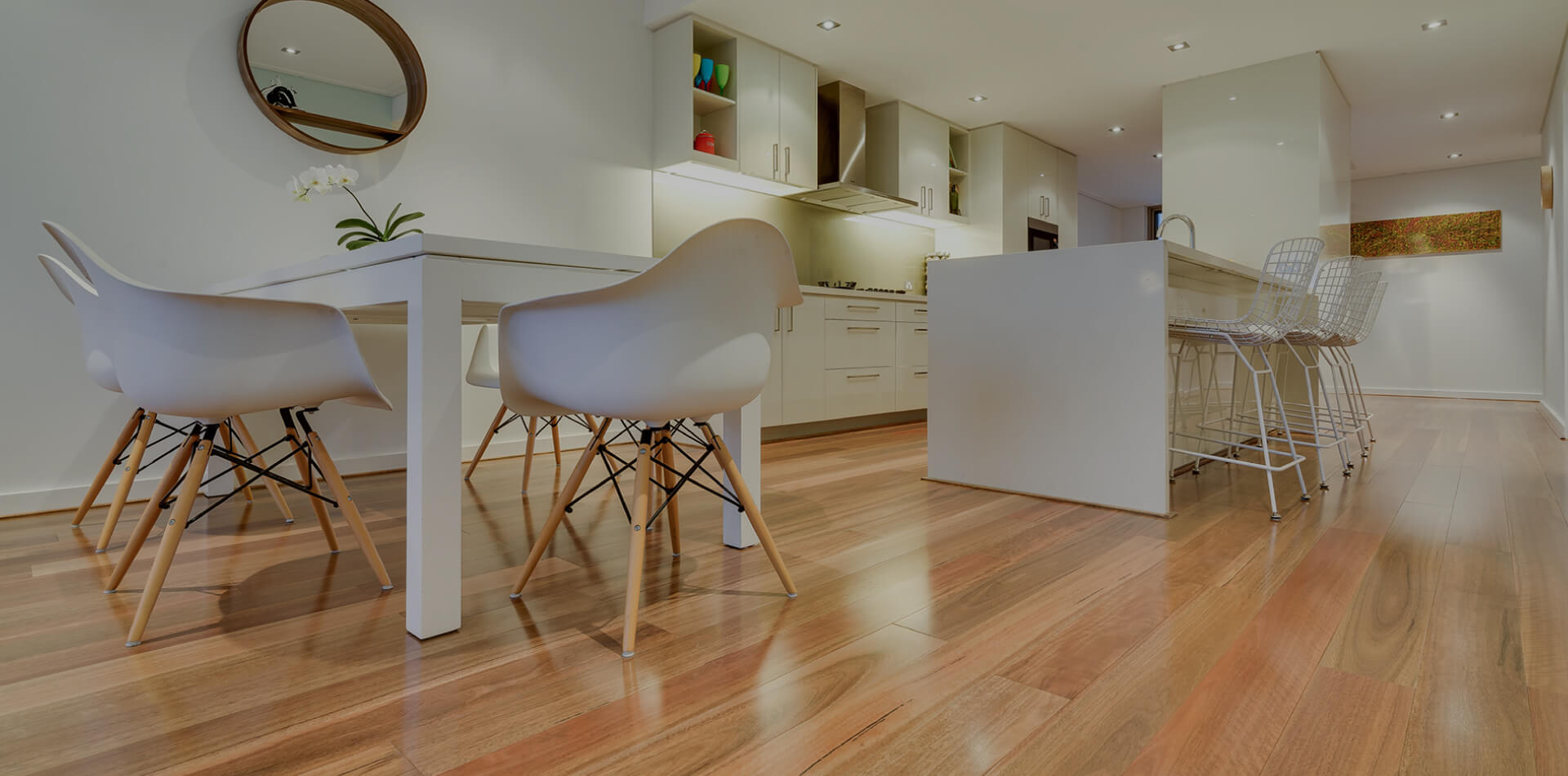 Room with wooden flooring and small wooden legged chairs